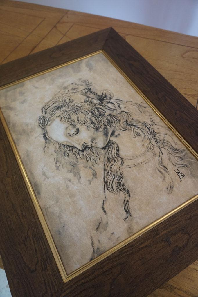 Grabado sobre madera del estudio de cabeza de mujer de Da Vinci realizado por la Artista Plástica Inma Peña en 2006